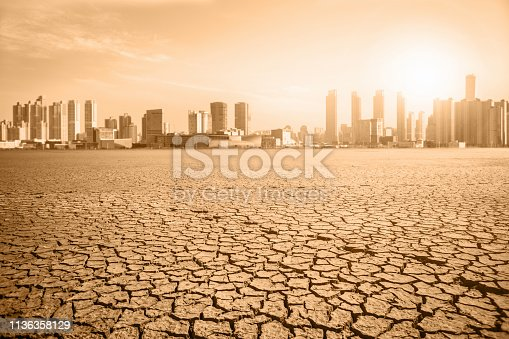 Post-apocalyptic landscape. City after the effects of global warming. Climate changes concept.
