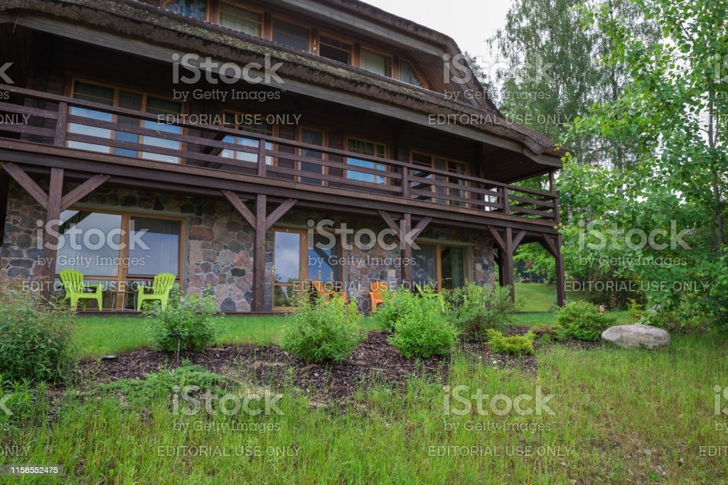 City Amatciems, Latvian republic. Guest house and green courtyard....