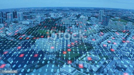 1090039252 istock photo City and digital technology concept. Digital transformation. Binary code. 1194803262
