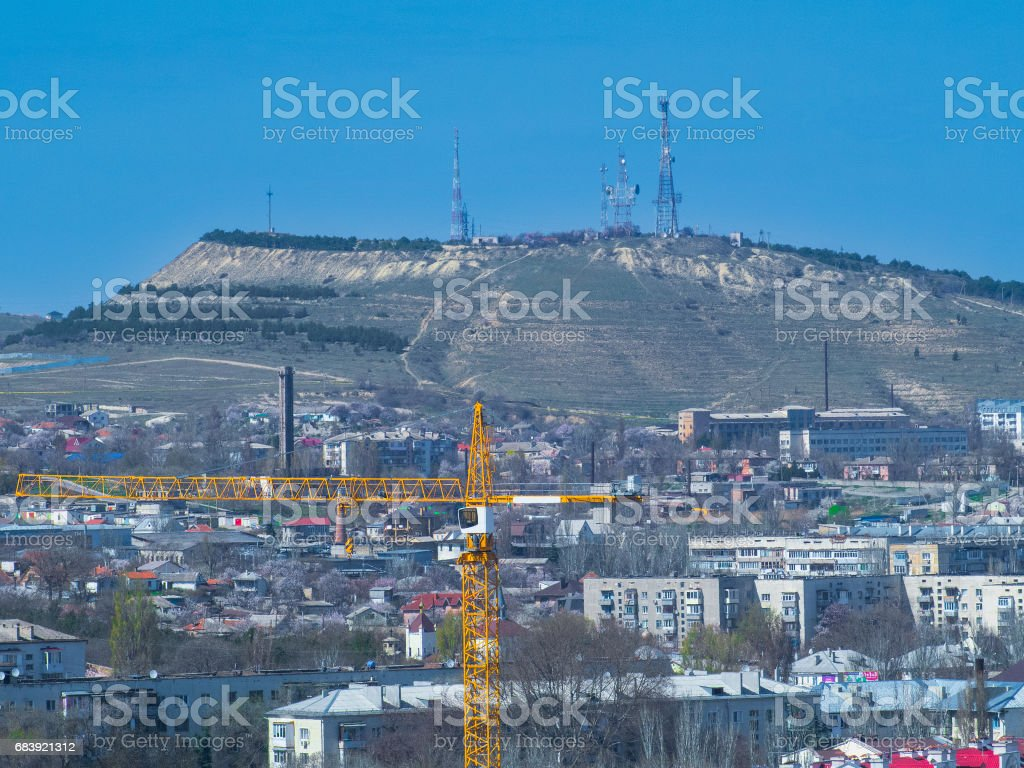 City and mountain with TV tower. Crimea. Feodosia. stock photo
