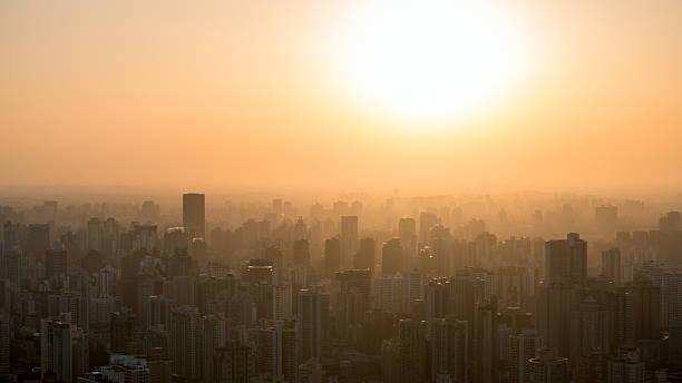 city at misty sunset. – Foto