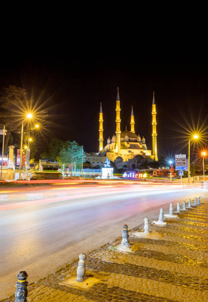 City at night Edirne, Turkey - August 28, 2019: Amazing night view at the streets in Edirne and Selimiye Mosque. Vertical view selimiye mosque night stock pictures, royalty-free photos & images