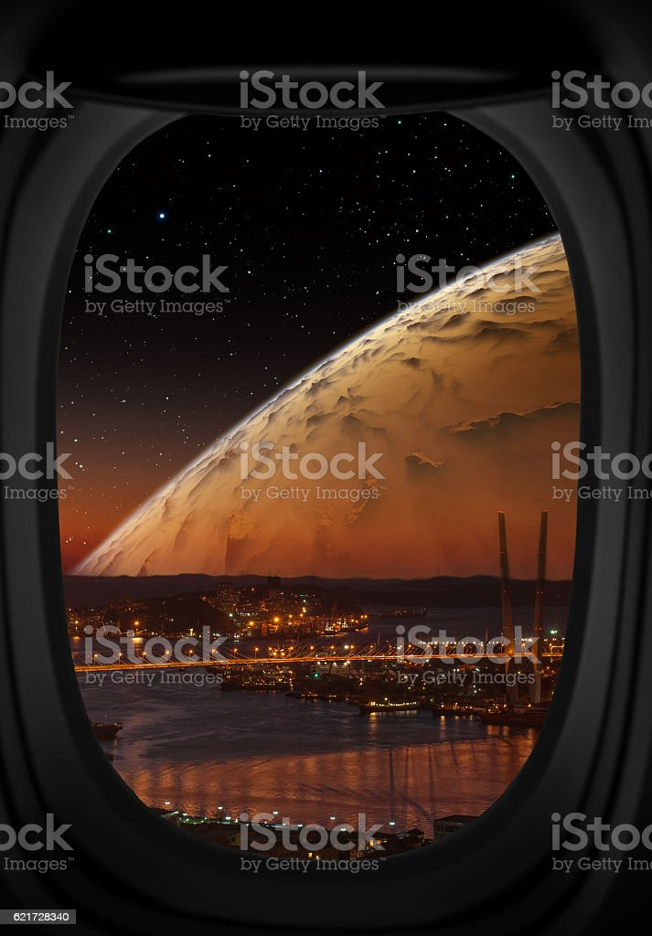 City at night with big planet. stock photo