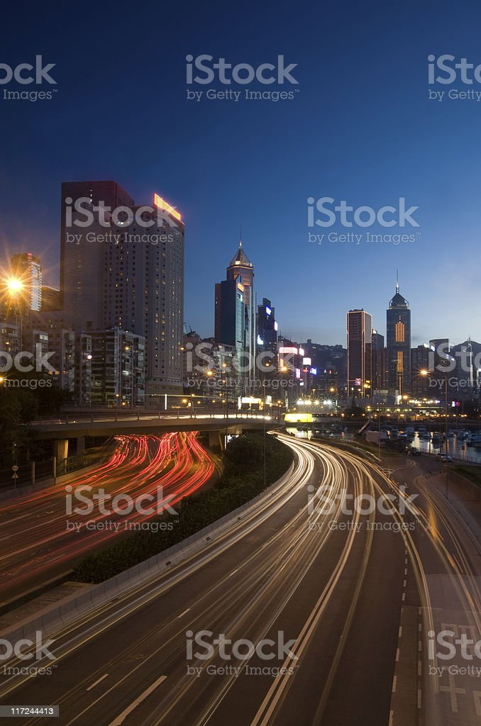 City at night with traffic trails stock photo