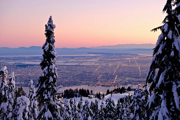 City at sunset from Grouse Mountain. Winter. – Foto