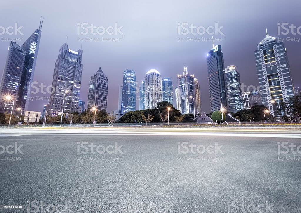 city avenue with modern buildings at night stock photo