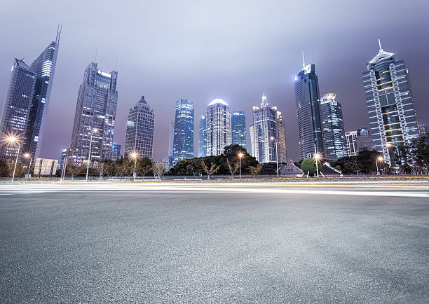 city avenue with modern buildings at night - Photo