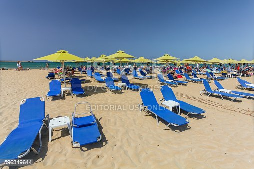 City Beach With People And Blue Daybeds Stock Photo & More Pictures of Beach