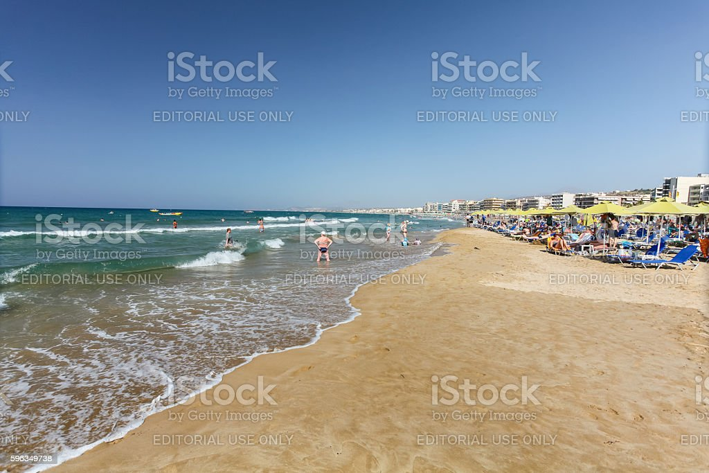 City beach with people and waves of Mediterranean Sea royalty-free stock photo