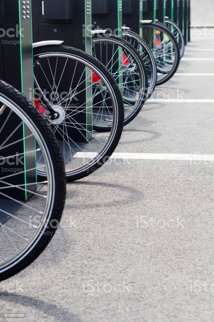 city bike stand with bicycles stock photo