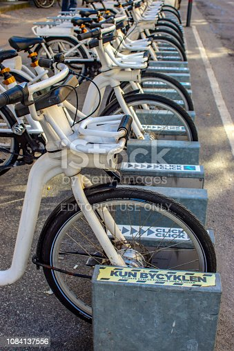 City bikes (Bycyklen) in docking stations in Copenhagen, Denmark. the bikes are available for short term hire by commuters or tourists and can be left at other docking stations around the city.
