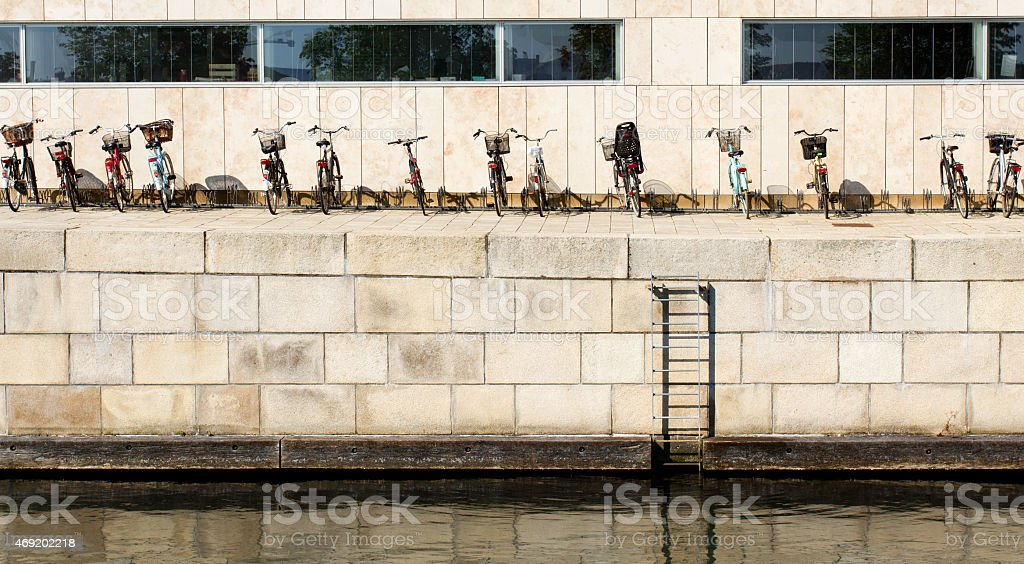 City bikes parked behind a public building in Copenhagen stock photo