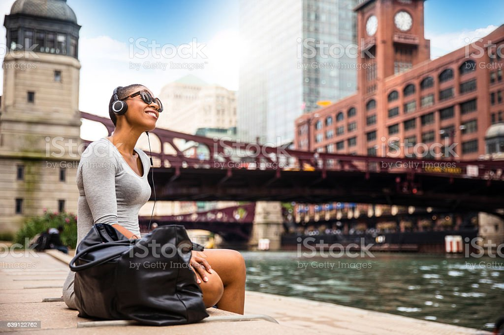 City break in Chicago - Woman relaxing at lunch time stock photo