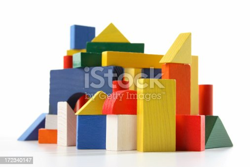 Urban scene in childrens wooden building blocks. Focused on the front blocks.
