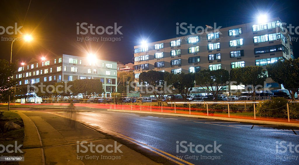 city buildings at night with traffic light streaks royalty-free stock photo