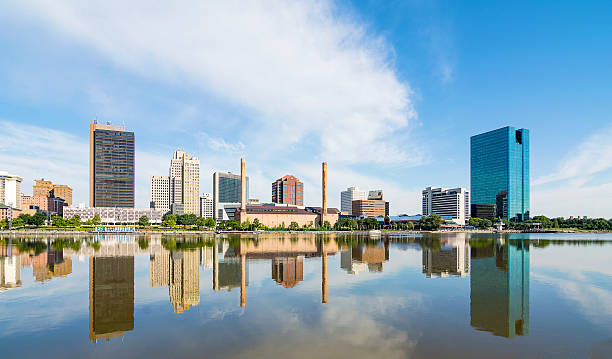 City buildings reflected on river stock photo