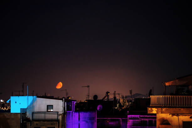 City by night - red moon in Athens, Greece stock photo
