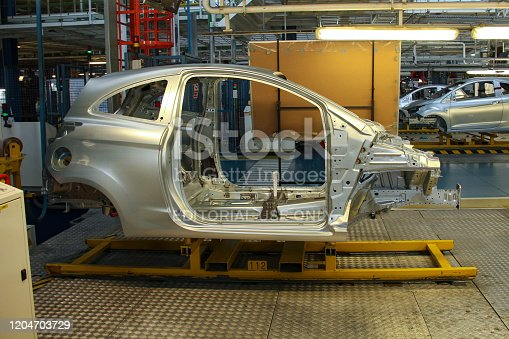 657996382 istock photo City car on a production line 1204703729