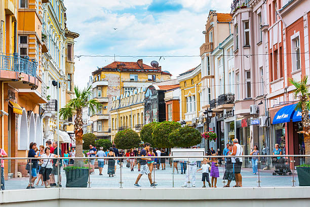 City center street with houses and people around stock photo