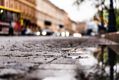 City central square paved with stone after a rain