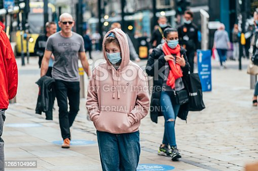 MANCHESTER, ENGLAND, UK - 24 JULY, 2020 City centre of Manchester, people in face masks while shopping