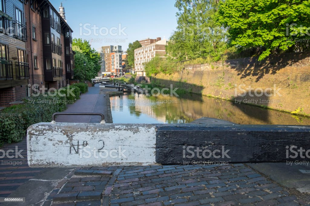 City centre / urban canal lock in Birmingham UK, with residential flats alongside the canal in the background stock photo