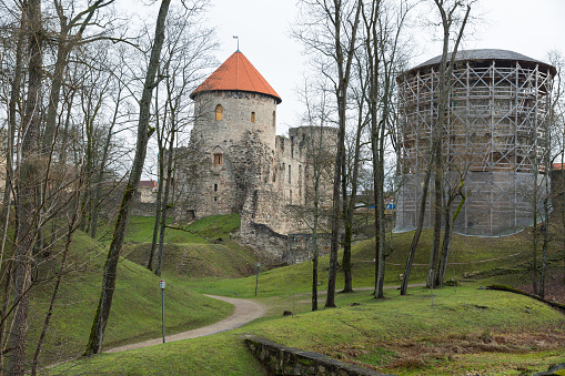 City Cesis, Latvia Republic. 13th century castle with park in late autumn. Historic building. 2. November 2019.