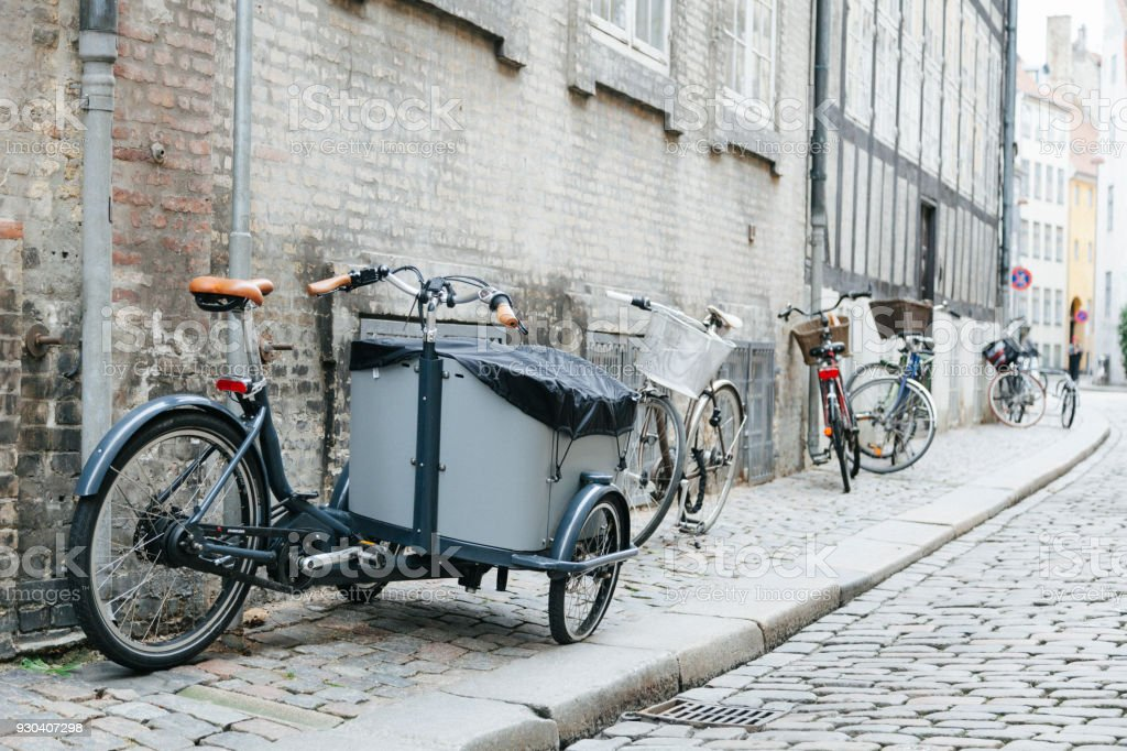 City cobbled sidewalk with bicycles stock photo