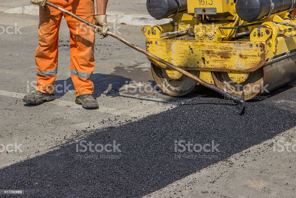 City crew install a new speed bump 2 stock photo
