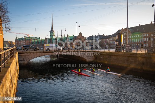 istock City downtown, wide canal in the city with tourists walking around and locals riding boats. 1300248336