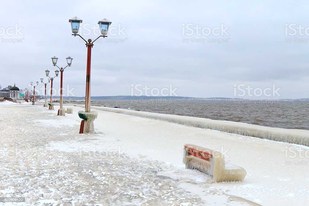 City embankment covered with ice after a winter storm stock photo