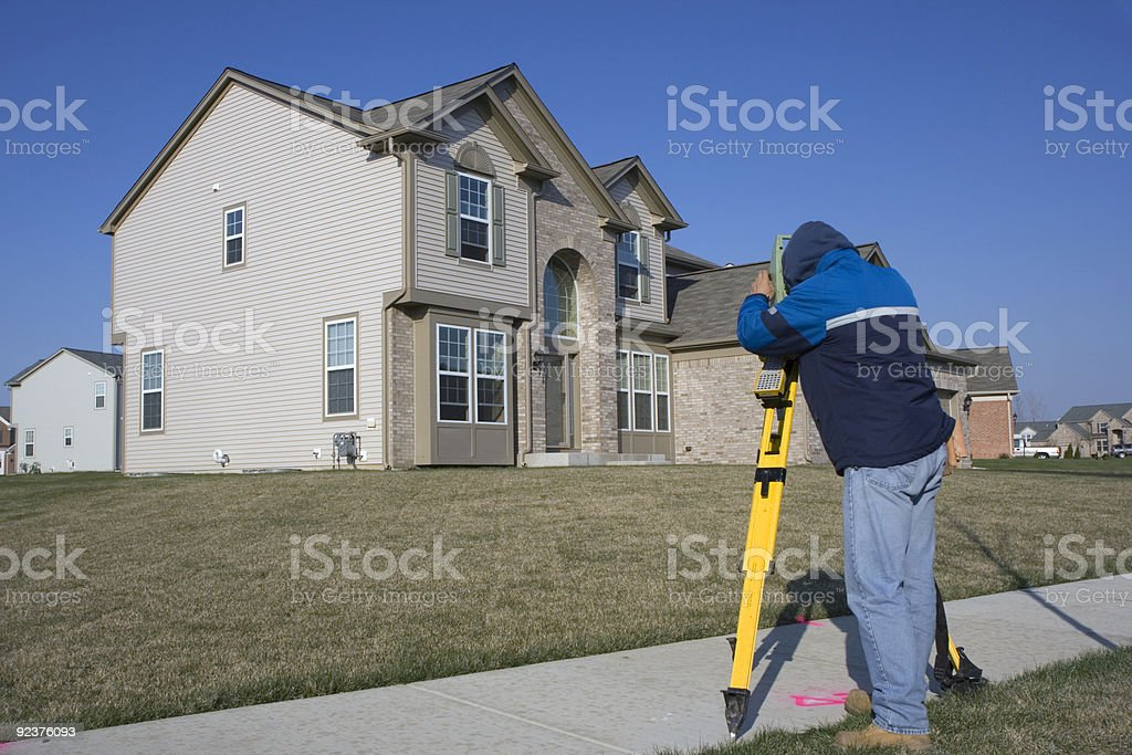 City employee surveying residential properties royalty-free stock photo