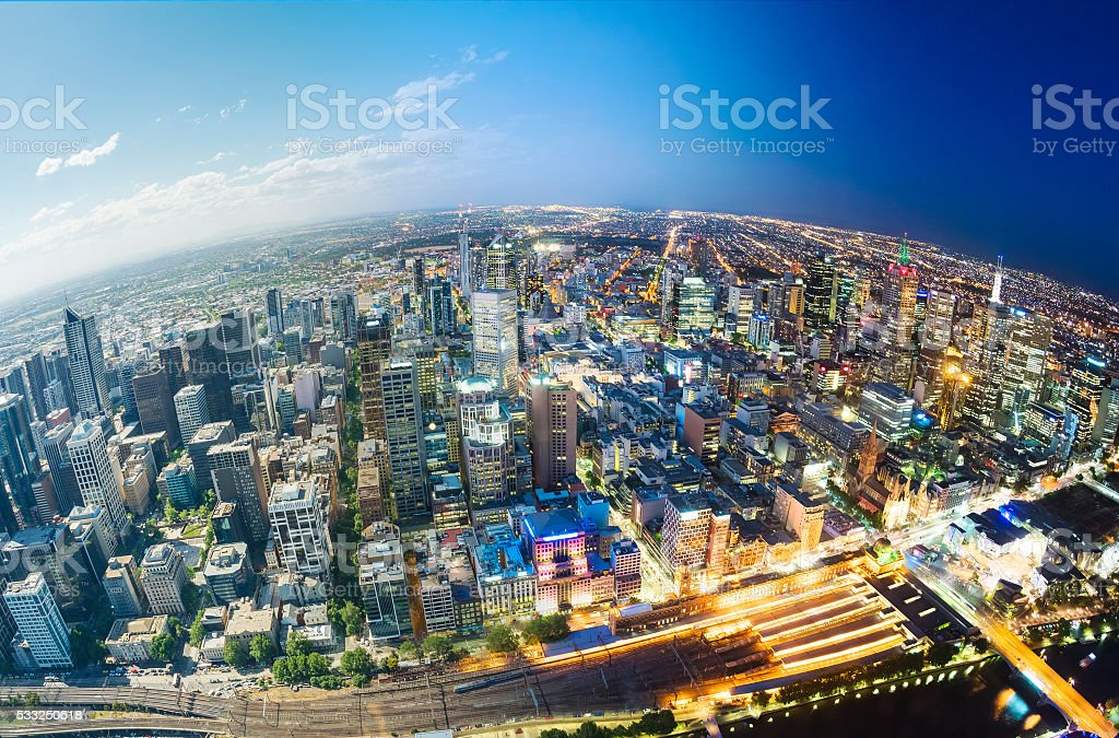 City fading from day to night stock photo