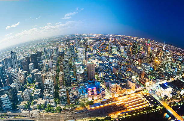 City fading from day to night Aerial view of Melbourne, fading from day to night fish eye lens stock pictures, royalty-free photos & images