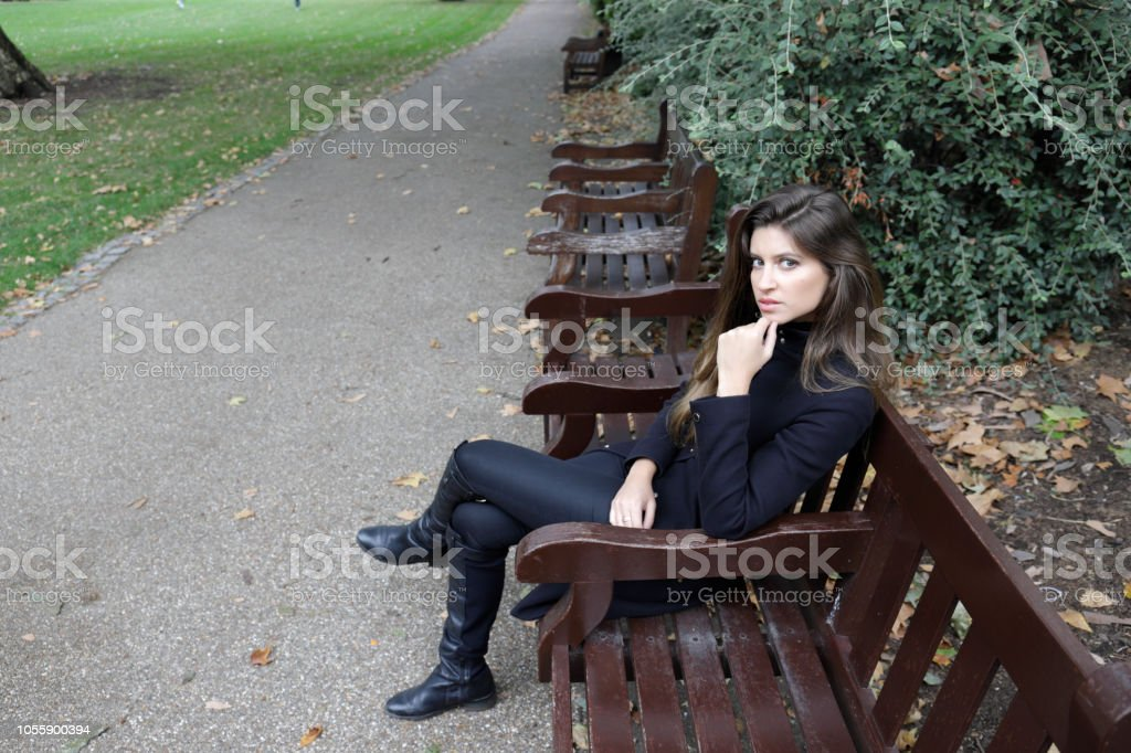City fashion London Russian outdoor girl black outfit hand on chin stock photo