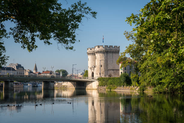 City gate and bridge over river Meuse in Verdun City gate and bridge over river Meuse in Verdun (France) on a sunny day in summer verdun stock pictures, royalty-free photos & images