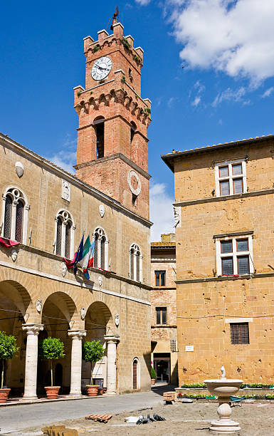 City Hall and Palazzo Borgia in Pienza, Tuscany, Italy Piazza Pio II with Palazzo Pubblico (City Hall) and Palazzo Borgia clearly visible. Pienza located in the Val d'Orcia (Orcia valley) in Tuscany Region was rebuilt from a village called Corsignano, which was the birthplace (1405) of Aeneas Silvius Piccolomini who later became Pope Pius II. Once he became Pope, Piccolomini had the entire village rebuilt as an ideal Renaissance town. pienza stock pictures, royalty-free photos & images