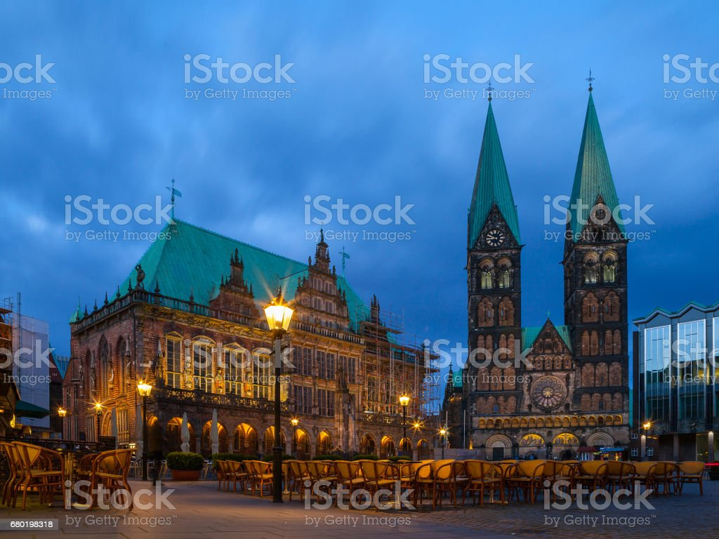 City hall and St. Peter Cathedral on the market square. Everining view with illumination. stock photo
