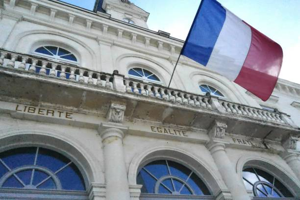 City Hall of Chatellerault in France City Hall entrance with french flag town hall stock pictures, royalty-free photos & images