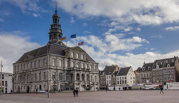 city hall on the central market square in maastricht - maastricht stockfoto's en -beelden