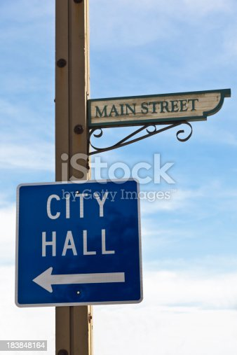 A City Hall Sign posted on Main Street.