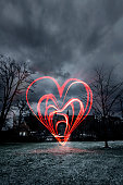 In the middle of the town a large heart has been painted with red light in the air