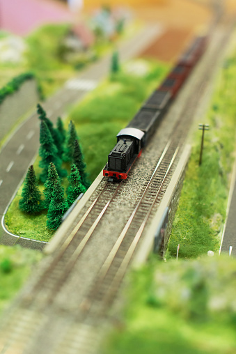 City in miniature. Miniature model of train with wagons.