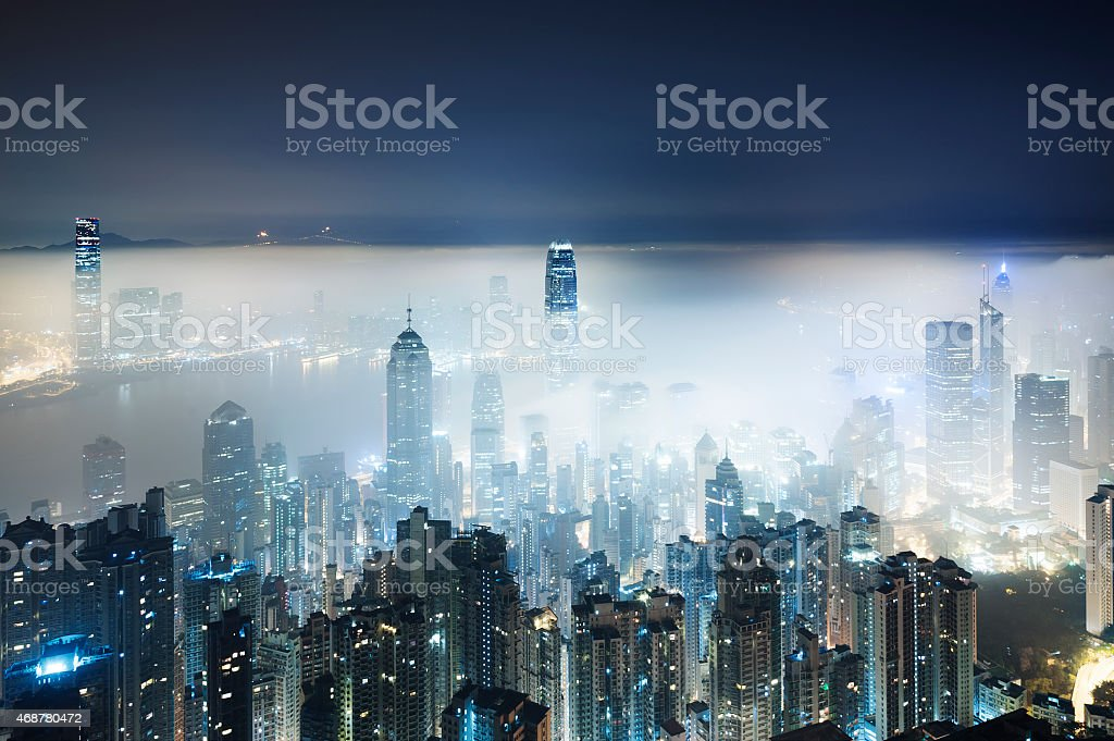 City in misty fog stock photo