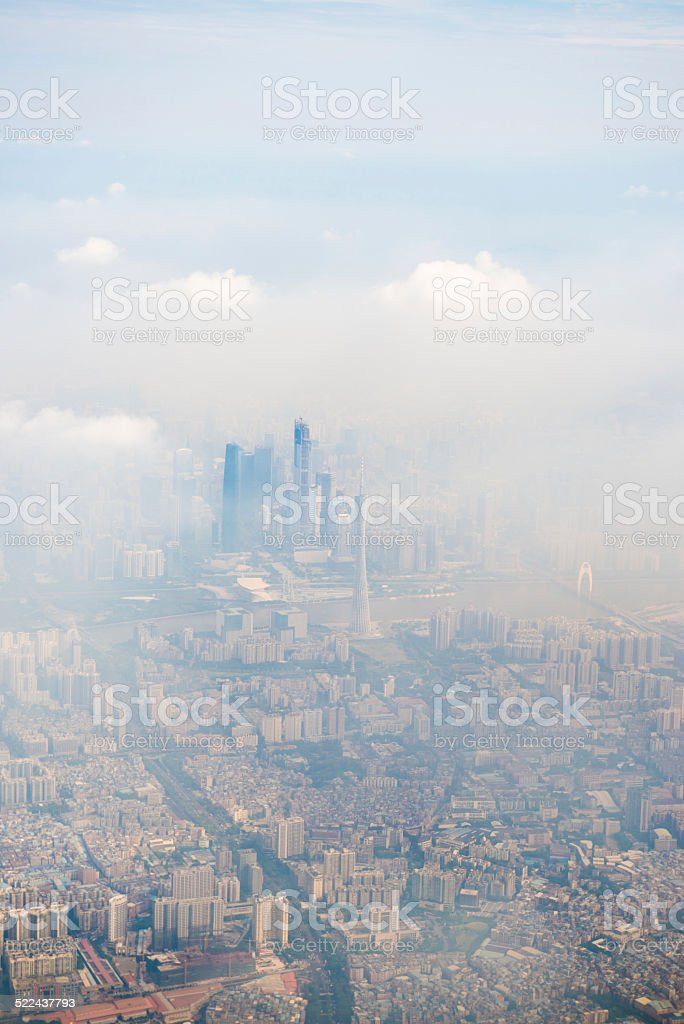 city in the fog stock photo