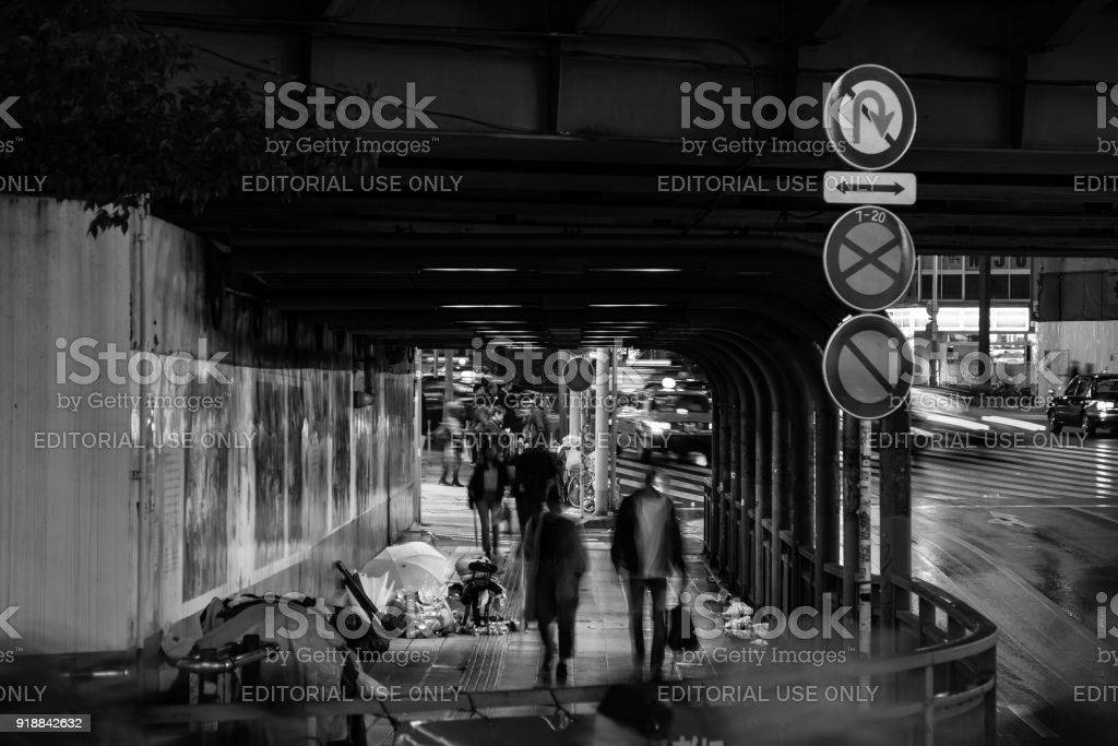 City In The Rain Desperate Homeless People Shelter Under Bridge On Rainy Night Royalty
