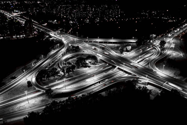 City interchange closeup at night , beautiful transport infrastructure background. Black and White. Aerial view stock photo