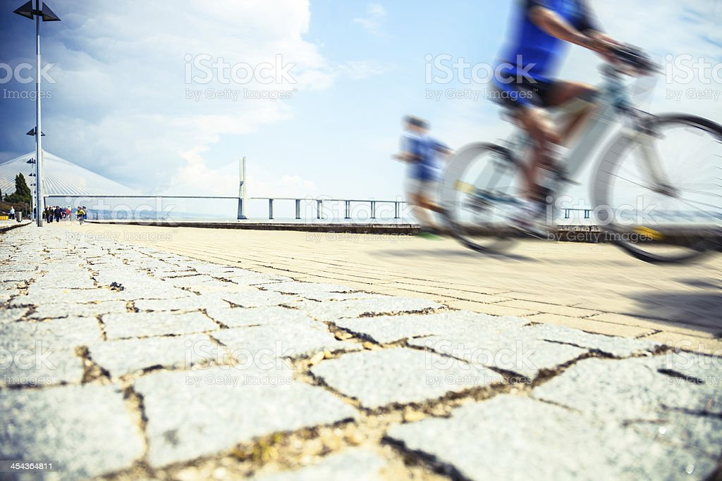 City jogging and cycling royalty-free stock photo