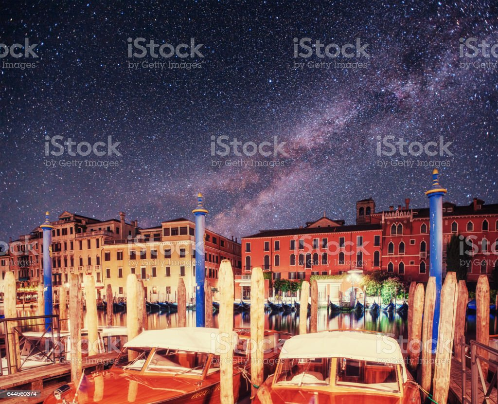 City landscape. Fantastic starry sky and the milky way. stock photo