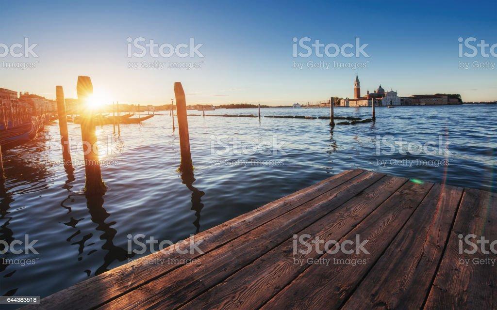 City landscape. Fantastic views of the gondola at sunset, moored stock photo